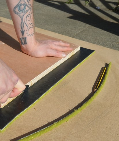 Cutting the carpet tiile with box cutter, 2