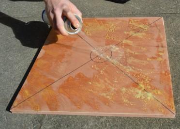 Spraying Carpet Adhesive.