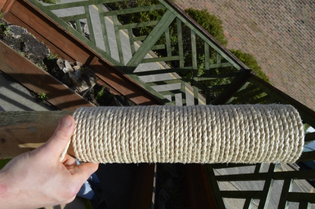 Wrapping rope around post.